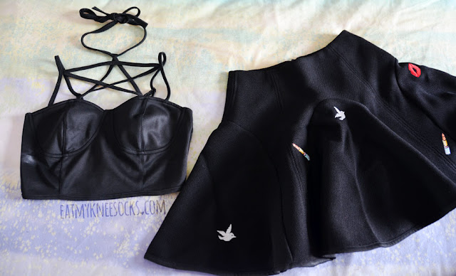 I got two items from Brandedkitty shop: a strappy pentagram bustier-style cropped bralet top and an embroidered Korean flared black skater skort.