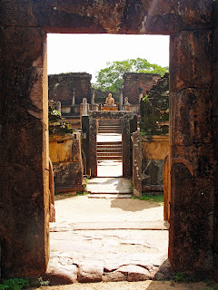 Peering through the ruins to a seated Buddha in the Polonnaruwa Vatadage