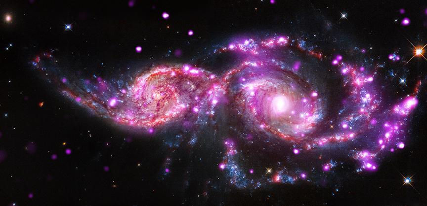 Встреча двух галактик NGC 2207 и IC 2163 в объективе космических телескопов