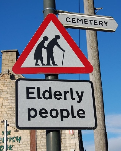 Road warning sign: Elderly People - to cemetery