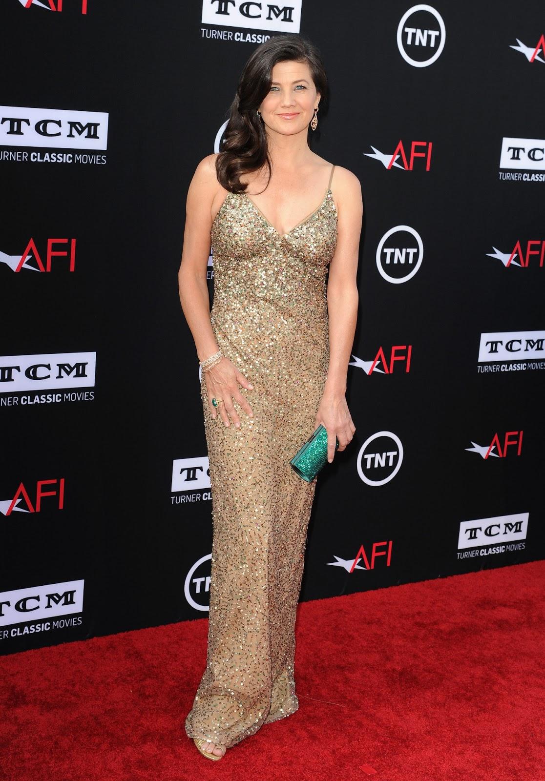 Retro Bikini: Daphne Zuniga dazzles in long gown at 2013 ...