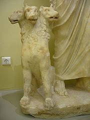 Cerberus next to the Greek God Hades.