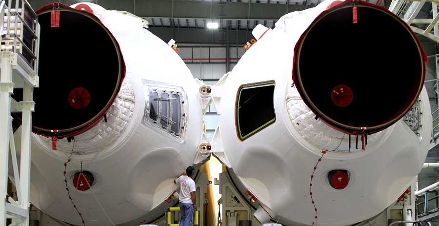 A United Launch Alliance technician monitors progress as core booster elements of a Delta IV Heavy rocket are being integrated in preparation for Exploration Flight Test-1. Image Credit: NASA/Ben Smegelsky