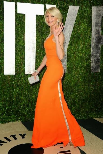 Cameron Diaz looked stunning in a figure-hugging vibrant orange gown from Victoria Beckham's Spring 2012 collection at the 2012 Vanity Fair Oscar Party hosted by Graydon Carter at Sunset Tower on February 26, 2012 in West Hollywood, California. The beautiful actress paired her bold tangerine-coloured dress with grey mist shoes, David Webb jewels, including a pair of oversized diamond chandelier earrings and a thick bangle, and a matching minaudière.