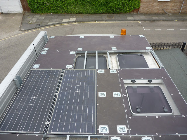 The roof rack solar panels and decking looking towards the cab