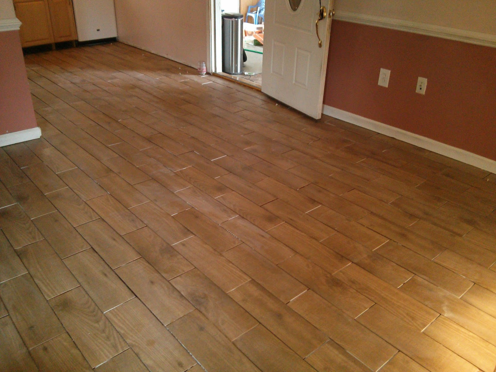Floor installation photos wood look porcelain tile in for Tile and hardwood floor