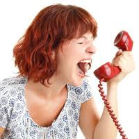A hysterical woman yelling into a telephone receiver