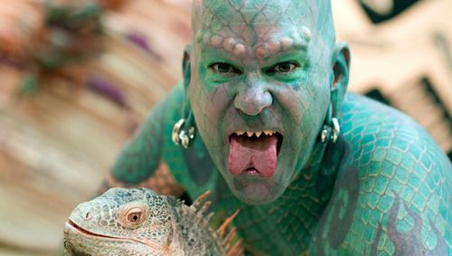 Aside from the tattooing of reptilian scales on his entire body, Erik Sprague
