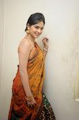 Madhumitha sizzling pics in saree-thumbnail-16