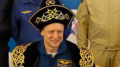 Dimitry Kondratyev smiles during the ceremony. NASA 2011.