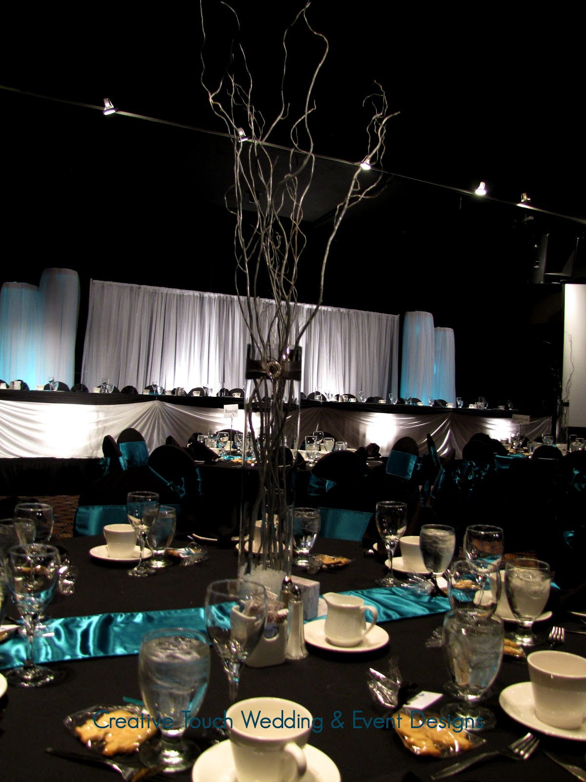 ... uplights teal runners black chair covers with teal satin sashes head