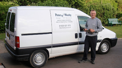 Peter standing in front of his van with a 'Peter Worby Antiques Restoration' advert on the side panel