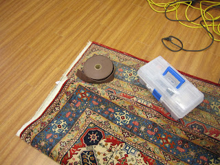 how to stop a rug from curling