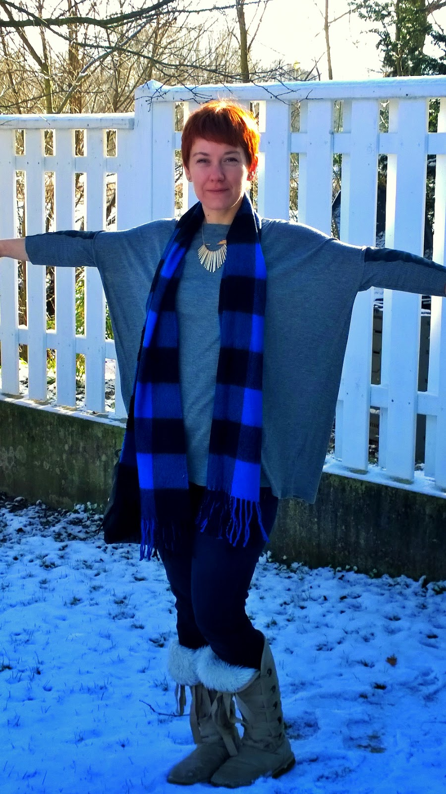 Buffalo plaid scarf, fake fur boots, skinnie jeans, batwing sleeves, fashion and style blog, red hair