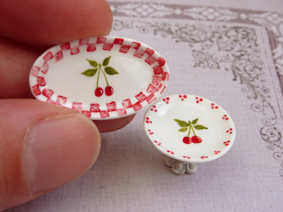 Handpainted miniature plate and cake stand in red and white with a cherry motif.Handmade by Paris Miniatures - Emmaflam and Miniman