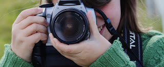 girl holding a camera