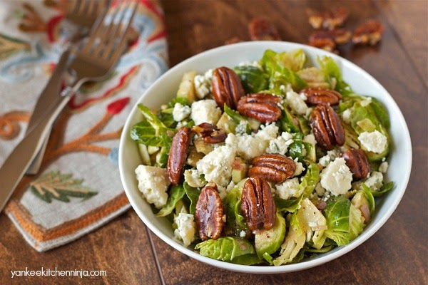 Simple Brussels sprout salad with blue cheese and maple candied pecans