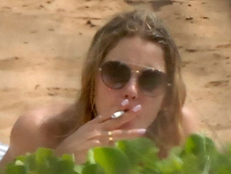 Well that didn't stop Ashley Benson from smoking a cigarette while hanging out to the beach in Maui, Hawaii on Tuesday, July 1, 2014.