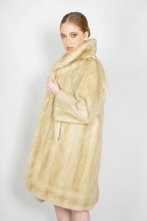 Vintage 1960's blonde mink fur swing coat with large collar and two front pockets.