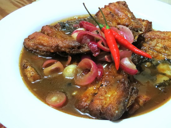 A plate of mouth watering bistek boneless bangus in thick brown sauce.
