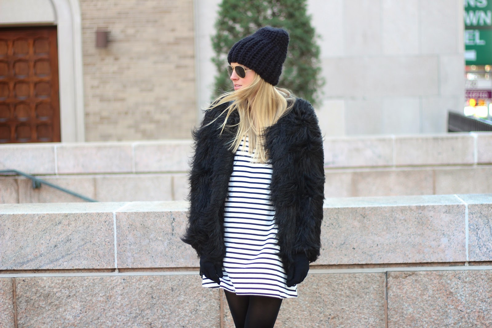 faux fur coat, black beanie, black and white dress, striped dress, black ankle booties