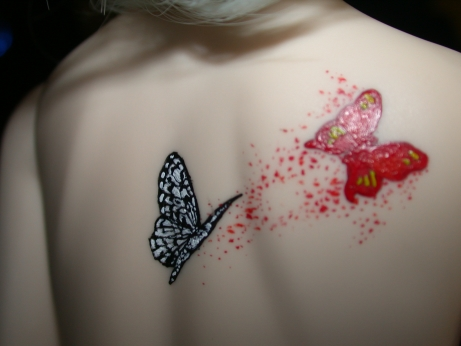 Many girls like to wear Celtic butterfly tattoos to dominate the world