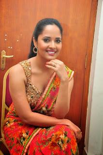 Anasuya lovely in Orange Saree Glittering Golden Sleeveless Deep Neck Blouse at Vinavayya Ramayya Movie Audio Launch