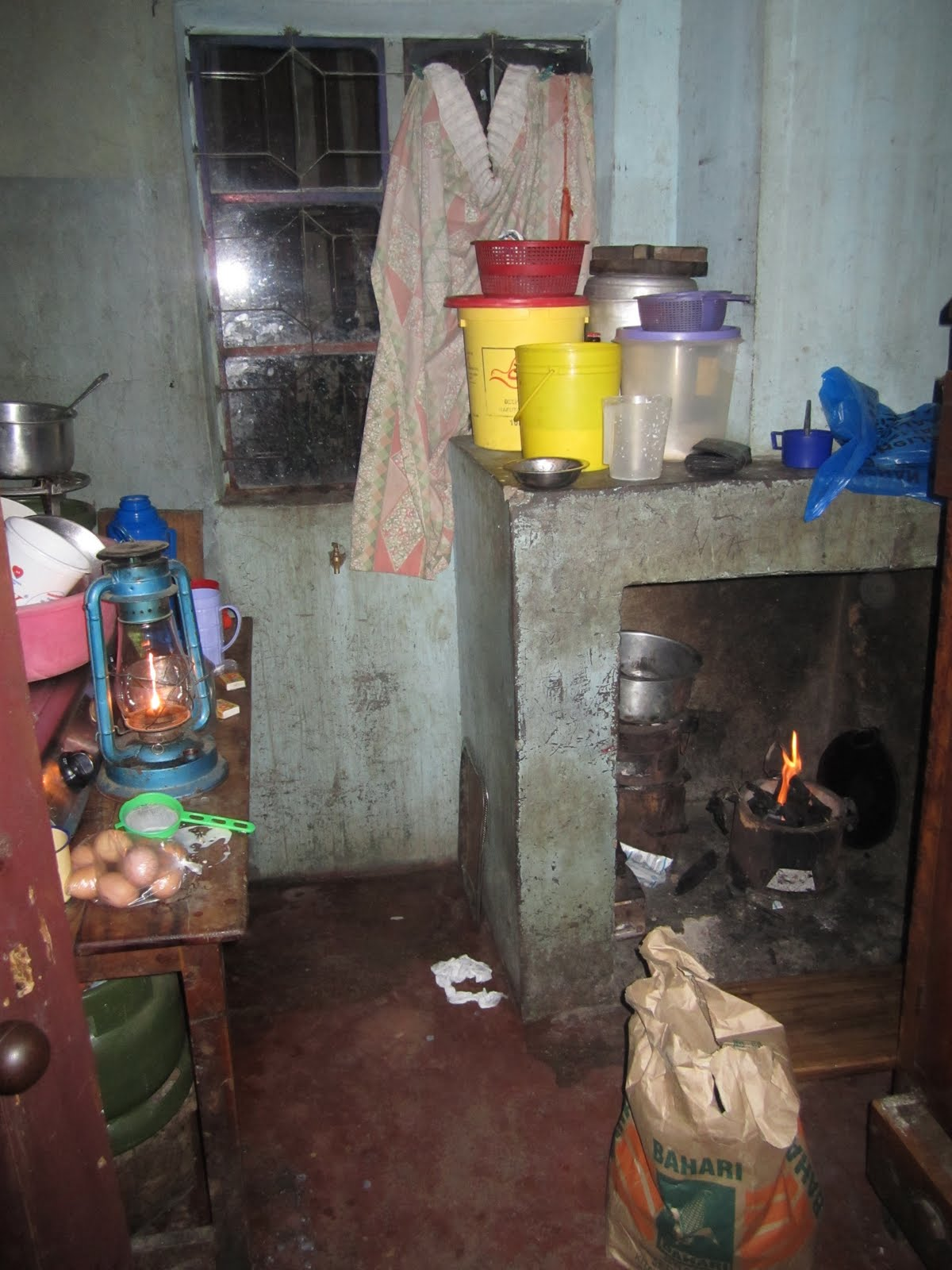 This is the kitchen all dishes would be cooked on the charcoal fueled jiko under the chimney theres a lantern on the table top because the electricity