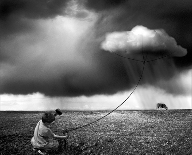 """The work of Alastair Magnaldo. His photos are for the ones who see stories all around them, the ones who dream of """"lying on fluffy clouds or frolicking among the stars,"""" and the ones who won't let their imaginations flicker out like a dying flame. They show us the power of dreams and imagination at play. More than anything, however, Magnaldo captures the magic of childhood and all of the sweet emotions that come with it."""