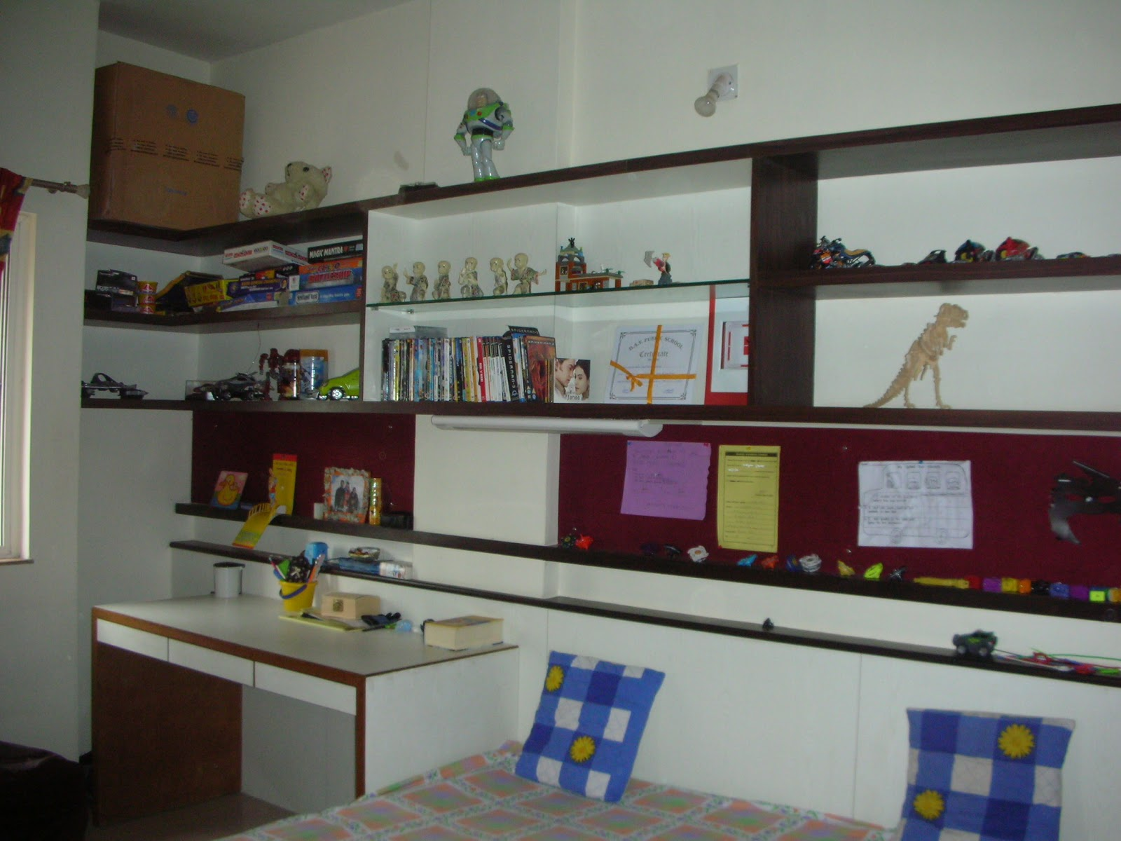 View of the study table and bed of children bedroom