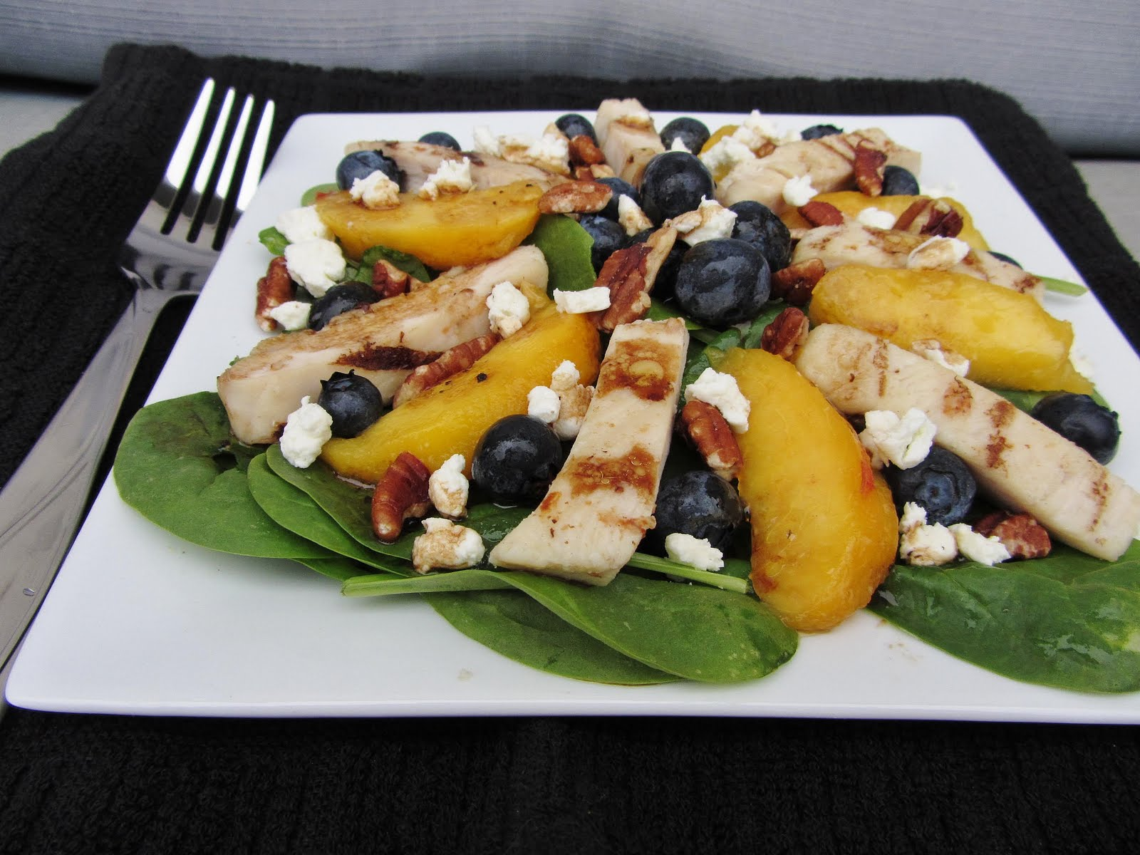 chicken spinach salad peaches blueberries goat cheese