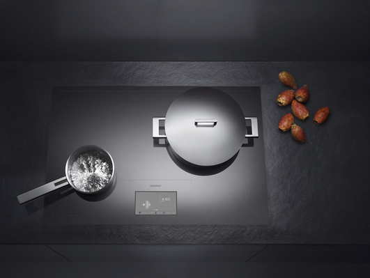 kitchen and residential design gaggenau just raised the bar on induction cooktops. Black Bedroom Furniture Sets. Home Design Ideas