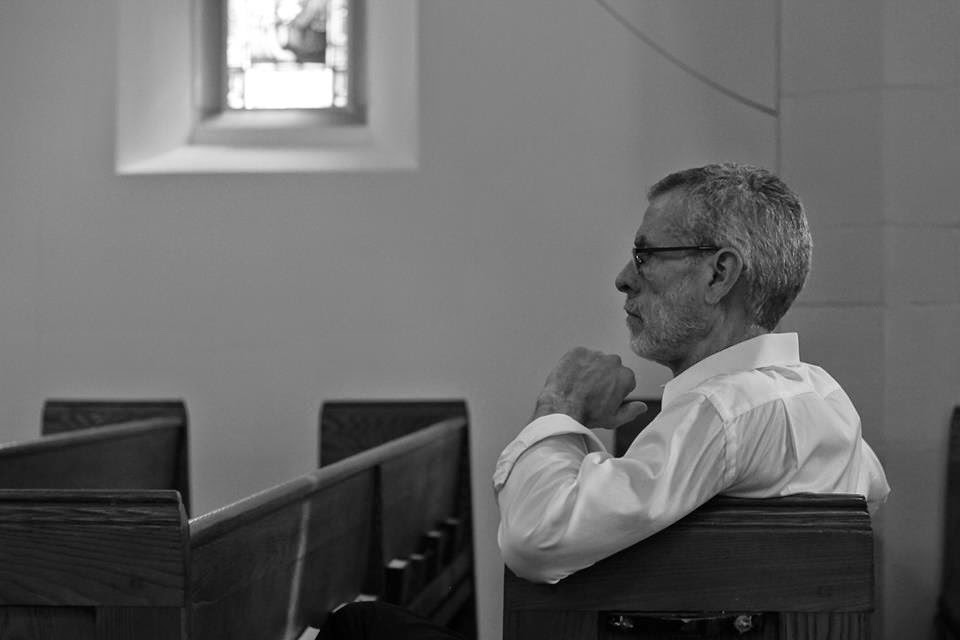 Steve Schalchlin in church watching rehearsal.