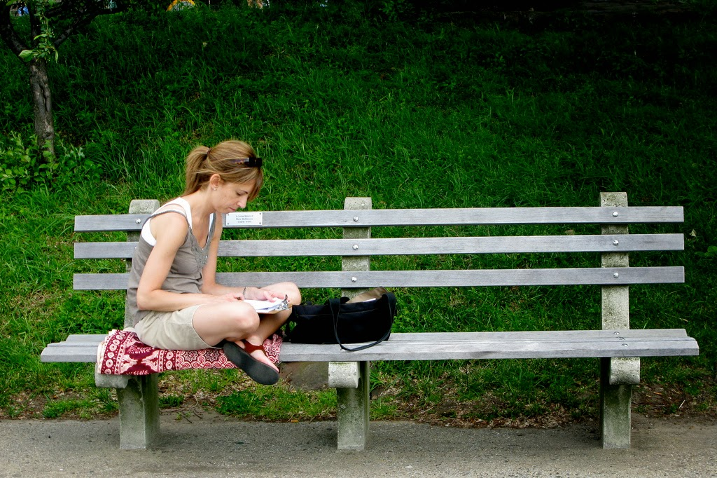 Woman Sitting on Bench Alone Reading