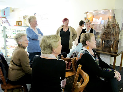 A group of customers waiting for the raffle to be drawn at the Fairy Meadow Miniatures shop VIP opening.