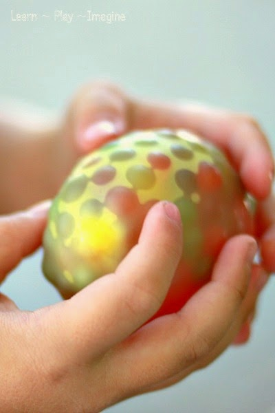 Fill water balloons with water beads for the coolest sensory experience ever!