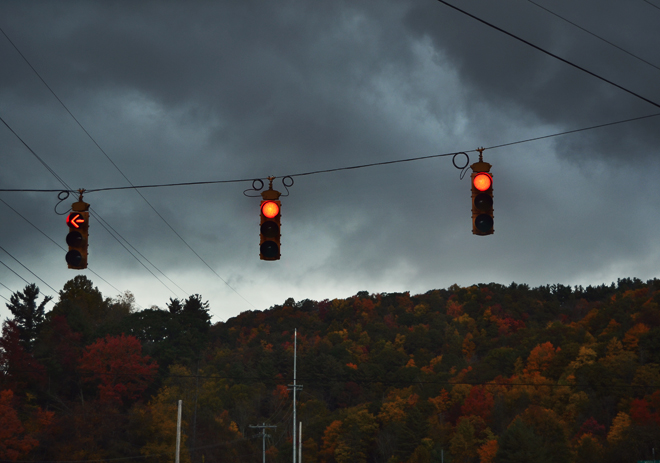 traffic lights, autumn leaves, stormy clouds