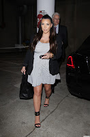 Kim Kardashian pregnant in a stripped short dress