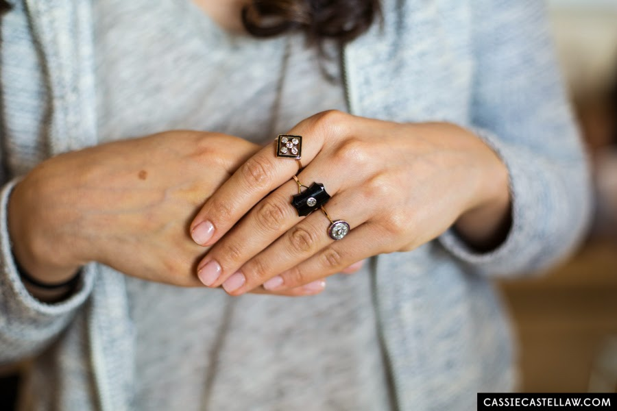 Black and gold vintage diamond cocktail rings worn by bridesmaid. Lifestyle wedding photography by Cassie Castellaw. www.cassiecastellaw.com
