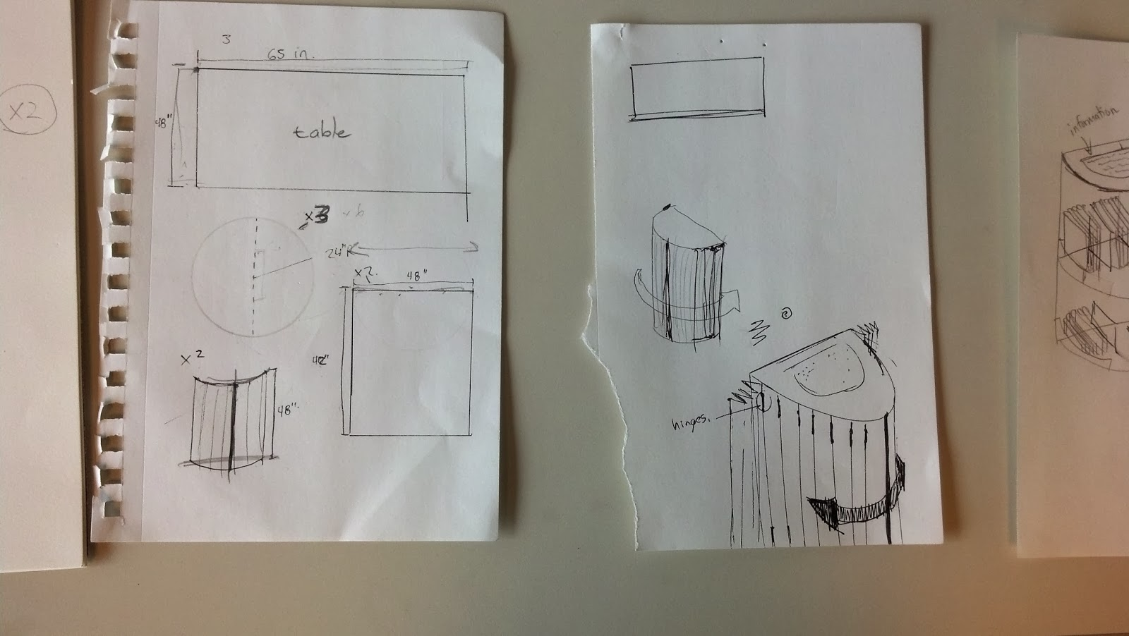 Image shows two pages pinned to a wall. The pages contain sketches of panel sizing and foldable screen doors for the round side sections of the exhibit display.