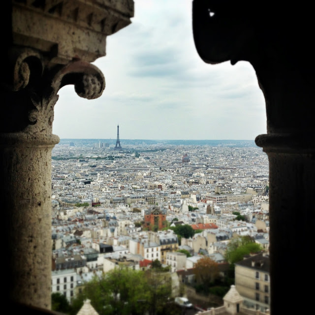 View of the Eiffel Tower through the columns on the roof of the Sacre Coeur in Montmartre Paris