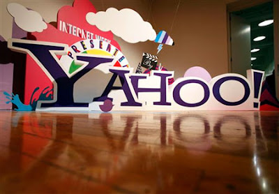 Yahoo 2Q revenue drop overshadows earnings gain.