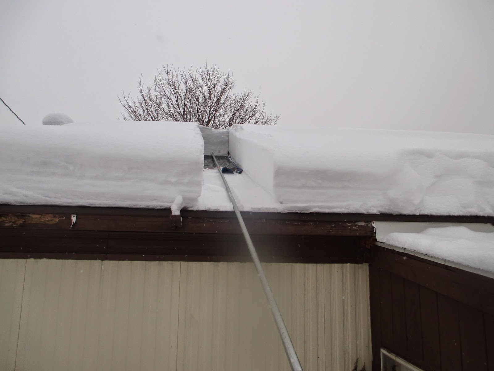 This First Push Up The Roof Shows How Nicely The Tool Slices Through And  Releases The Snow.