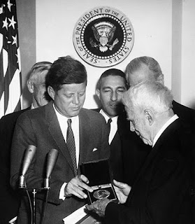 John F. Kennedy awarding Frost the Congressional Gold Medal