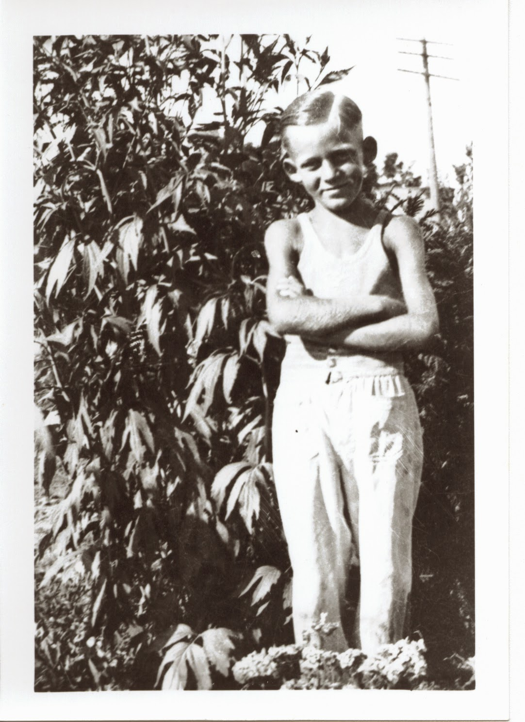 Grandpa Dwight as a young farm boy.