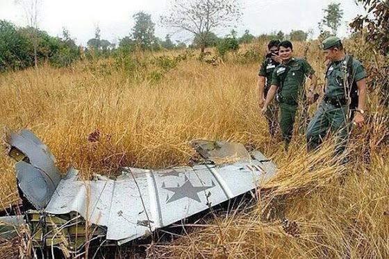 A piece of the F-16 fighter jet is found at the crash site