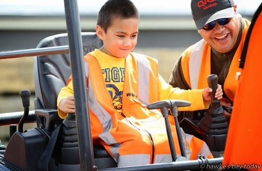L-R: Leyton Makea, Hastings; Jade Whirongi, QRS, Wairoa, operating a Hitachi excavator - kids' activity at the Hawke's Bay Excavators Competition, run by the New Zealand Contractors Federation, at the ENZA/Turners and Growers grounds at Whakatu photograph