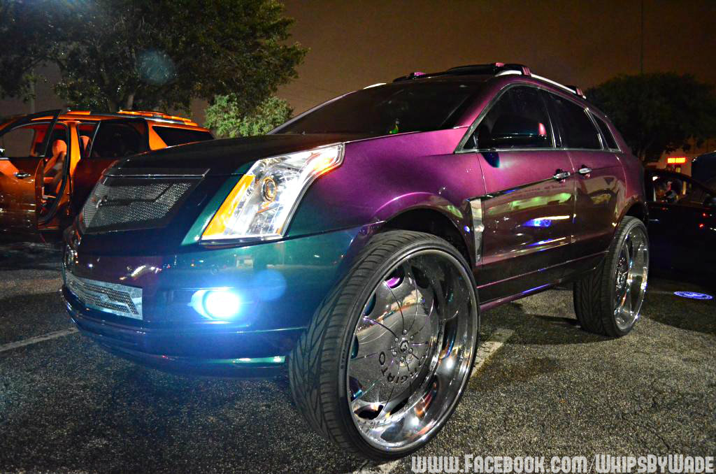 Outrageous Paint whipswade: cadillac srx on 32's