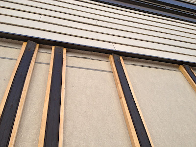strapping, flashing, rainscreen, clapboards