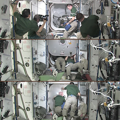 ISS crew closing the hatch after the crew of Mission STS-133 returned to the Shuttle Discovery – 7 March 2011. NASA, 2011.